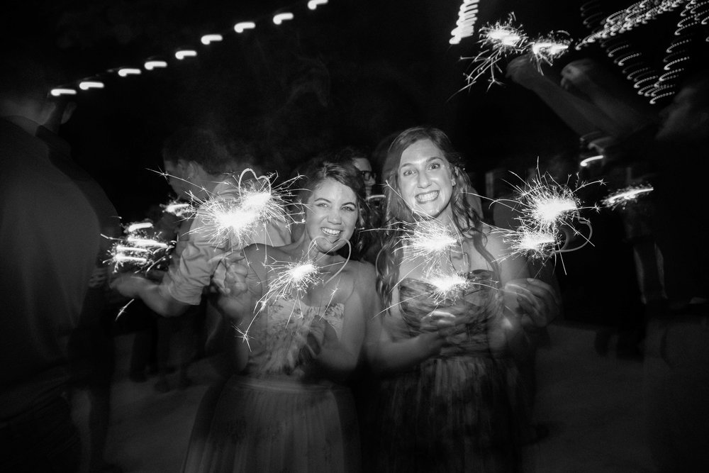 Wedding guests dancing with sparklers