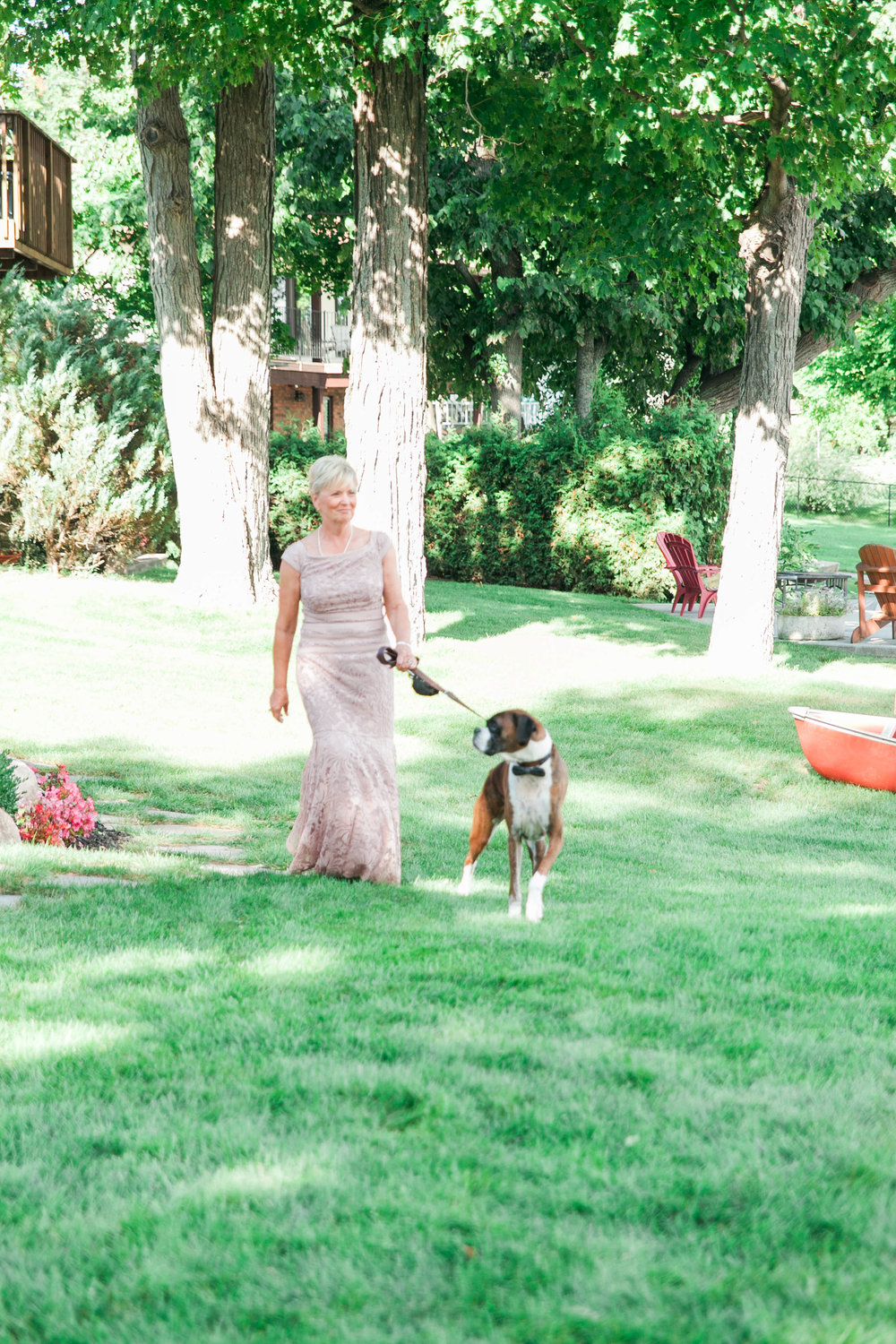 Mother of the bride and her dog walking down the aisle