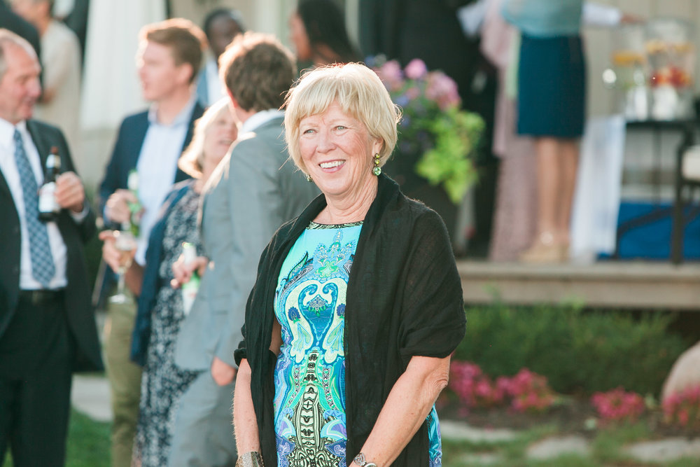 Wedding guest smiling during ceremony