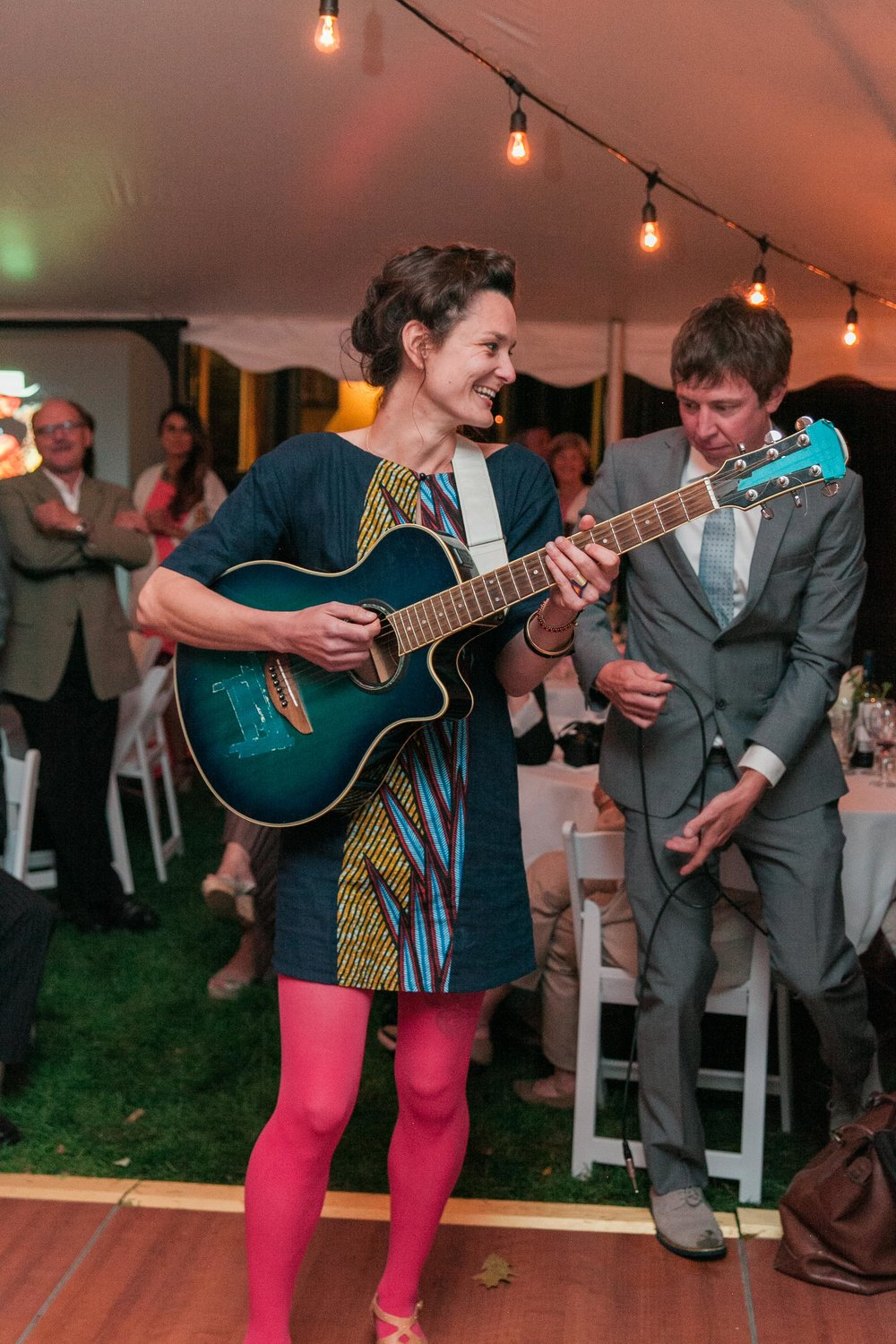 Friend playing guitar and singing at wedding