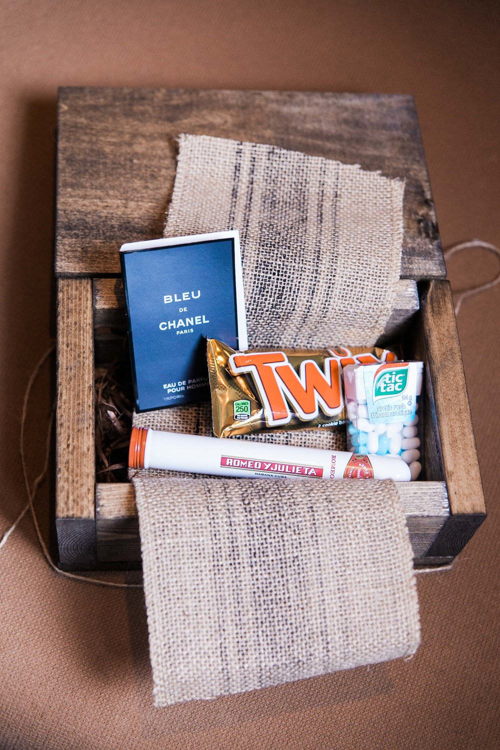 Homemade groomsmen gifts with candy and cigar