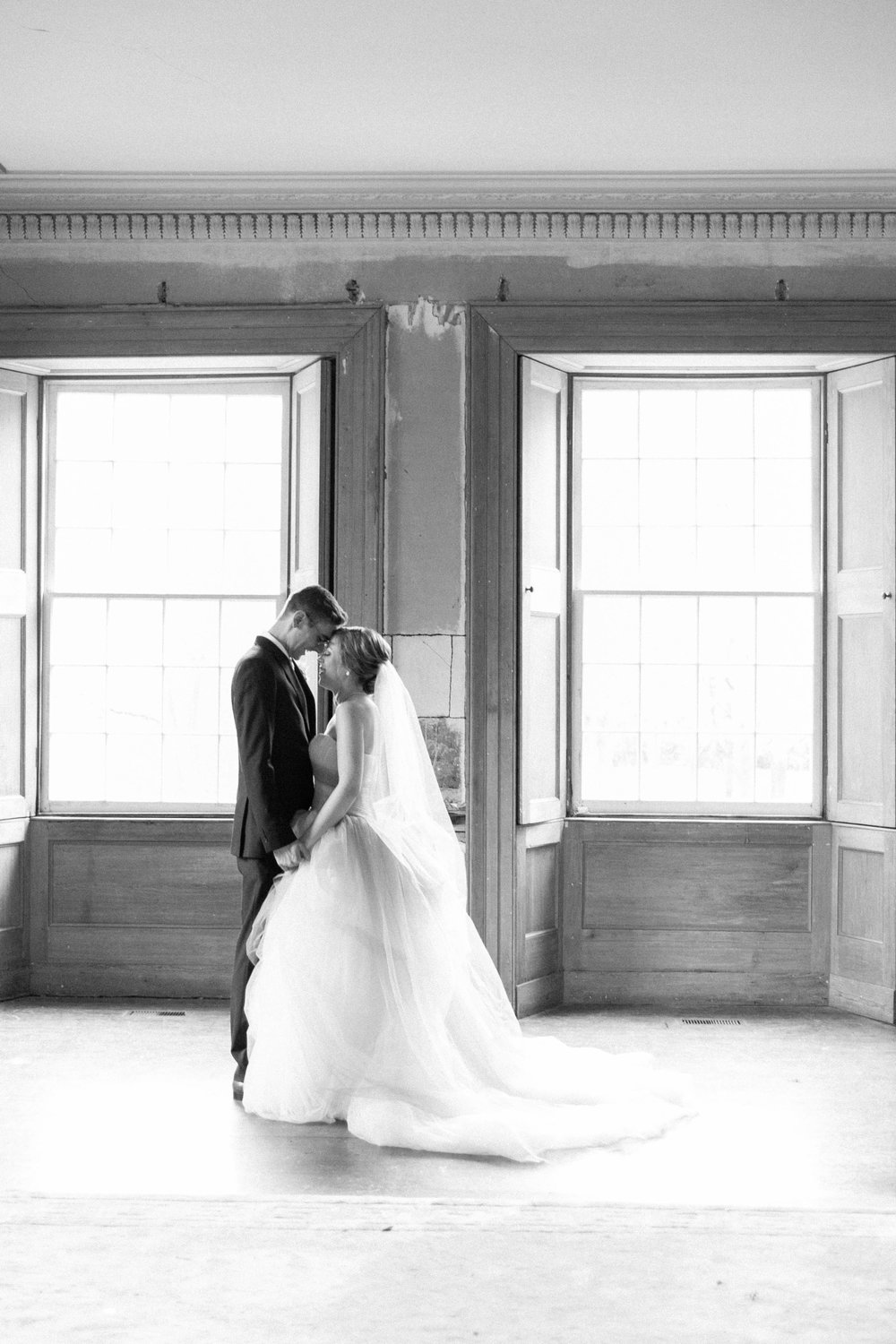 Black and white photo of bride and groom at Willowbank Estate