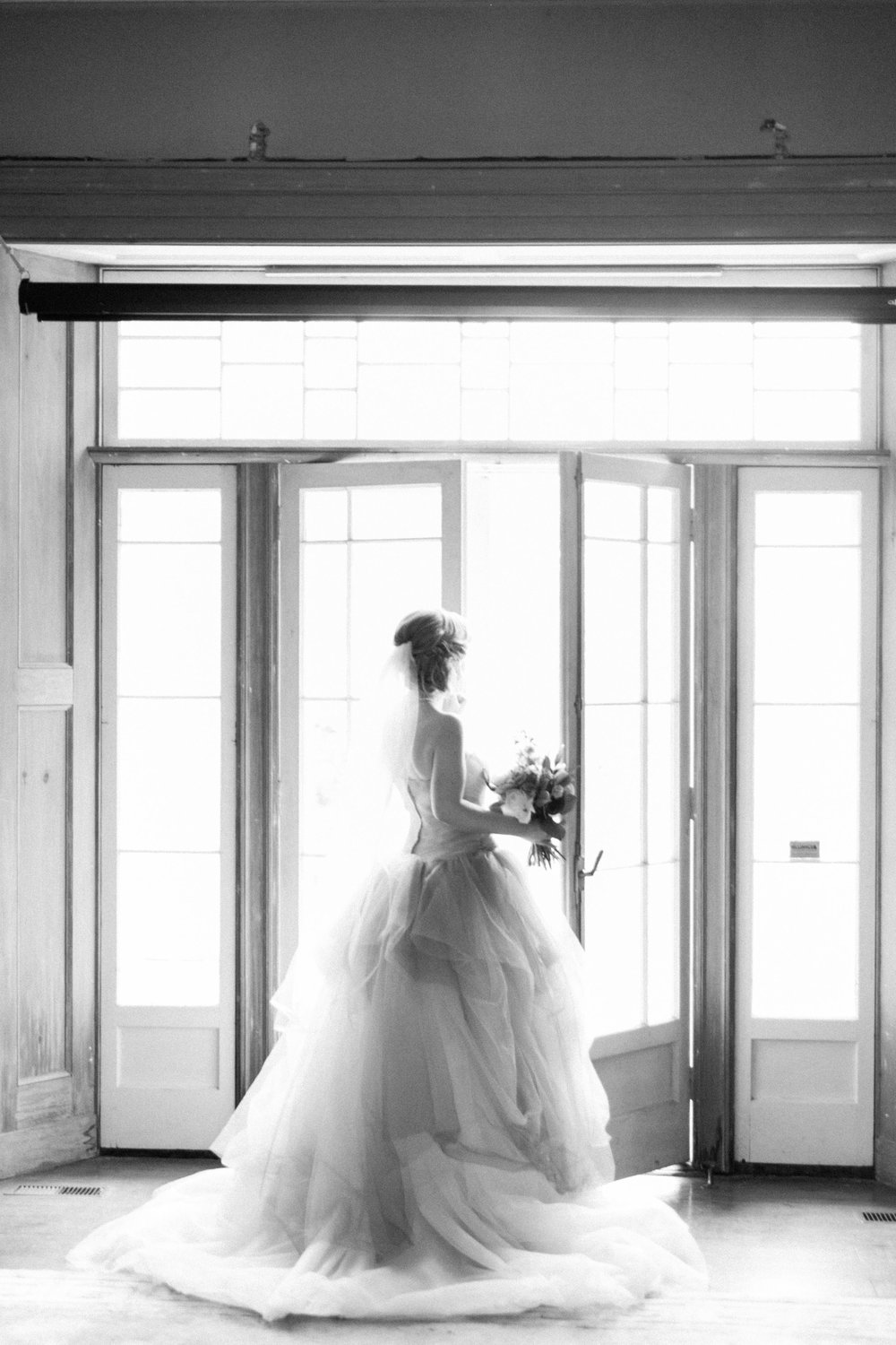 Black and white photo of bride in Vera Wang dress