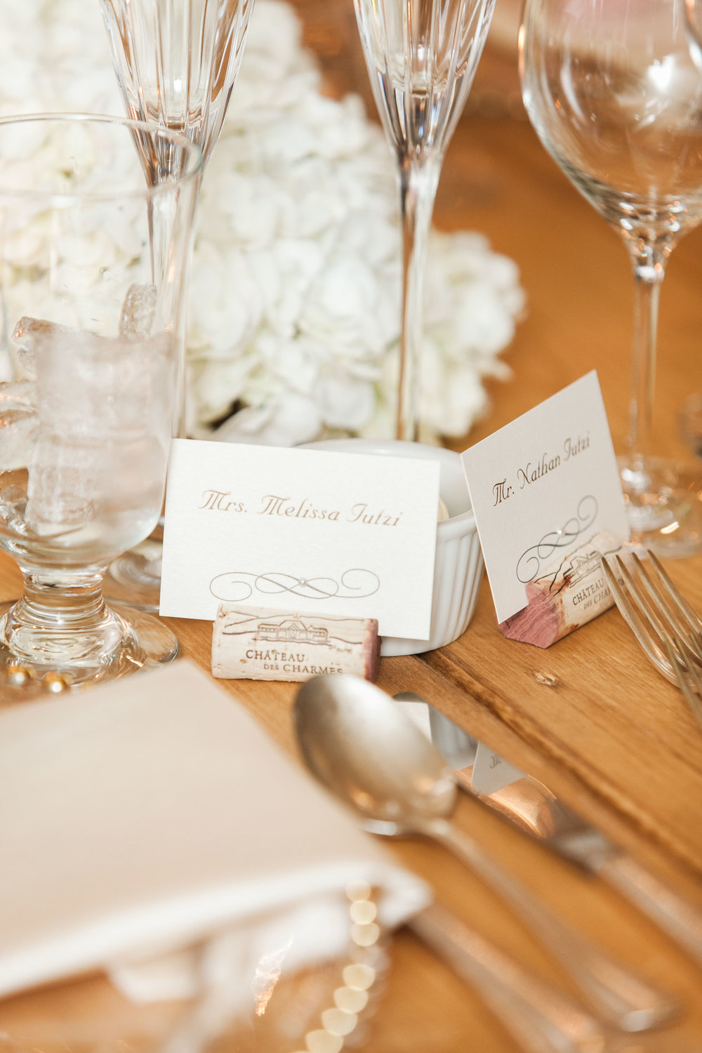 Wine cork place cards at tented wedding
