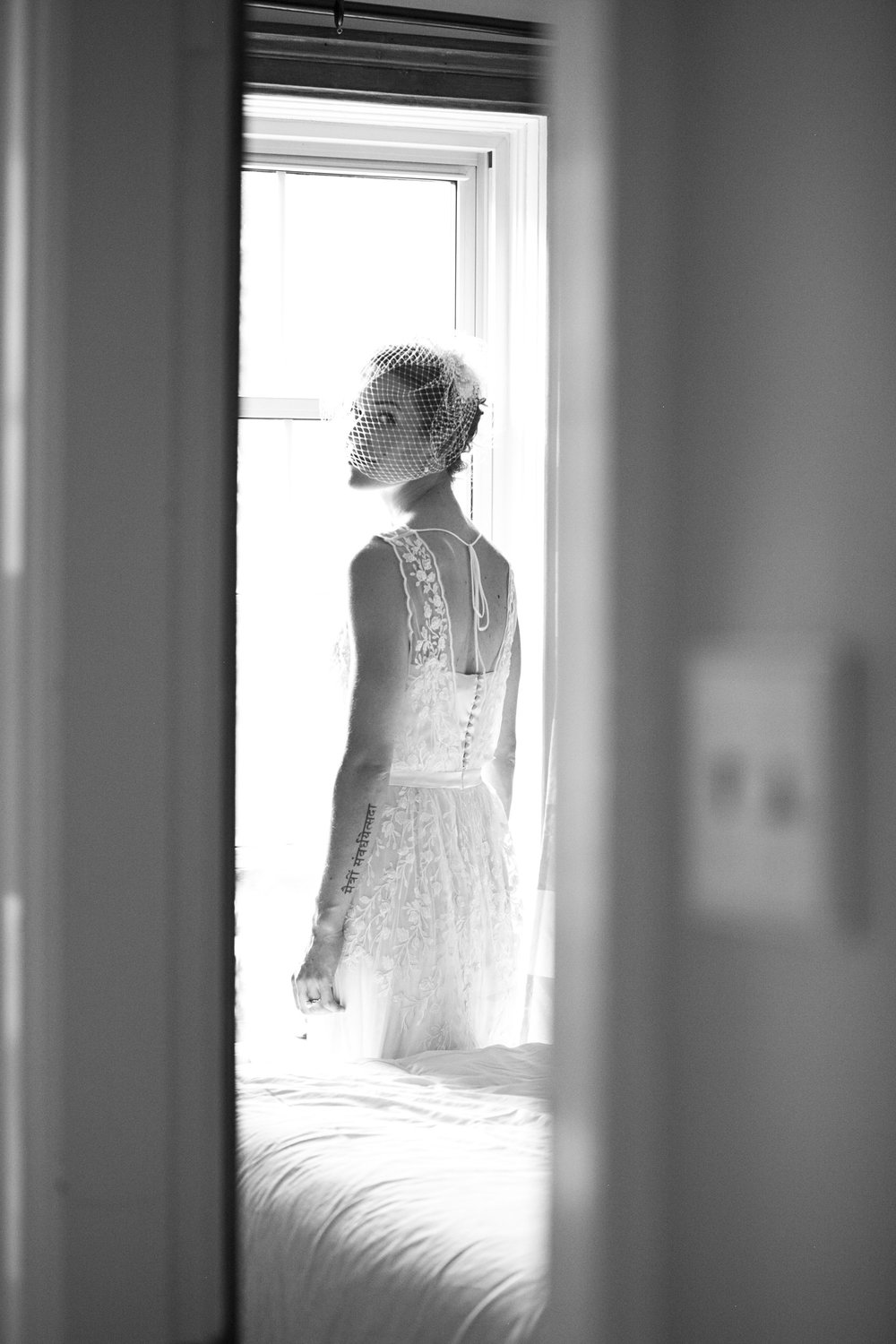 Bride in lace BHLDN dress