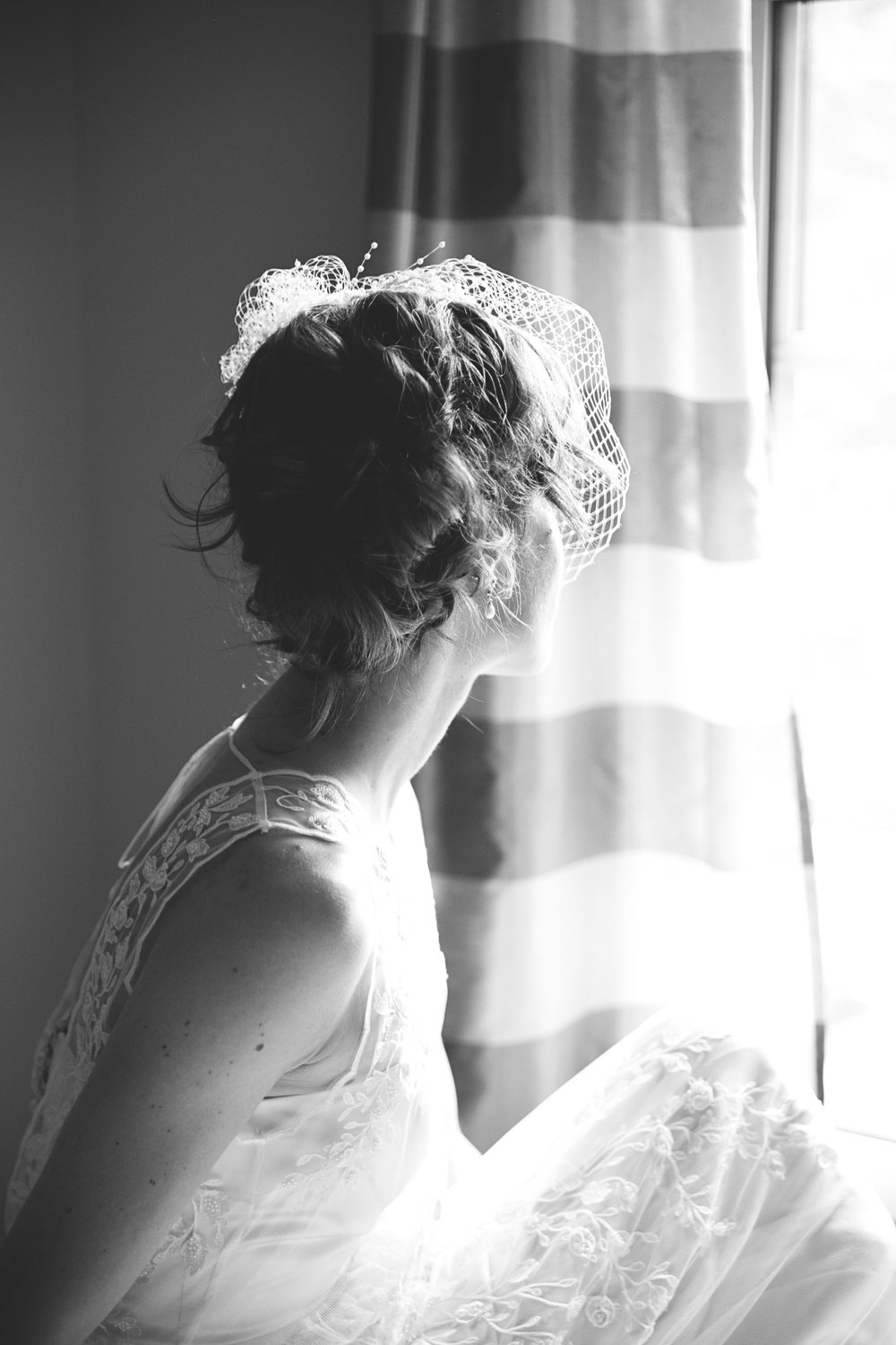 Bride wearing bird cage veil