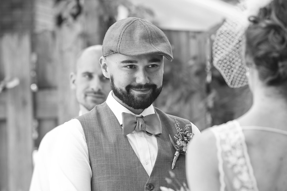 Groom smiling at bride at backyard wedding