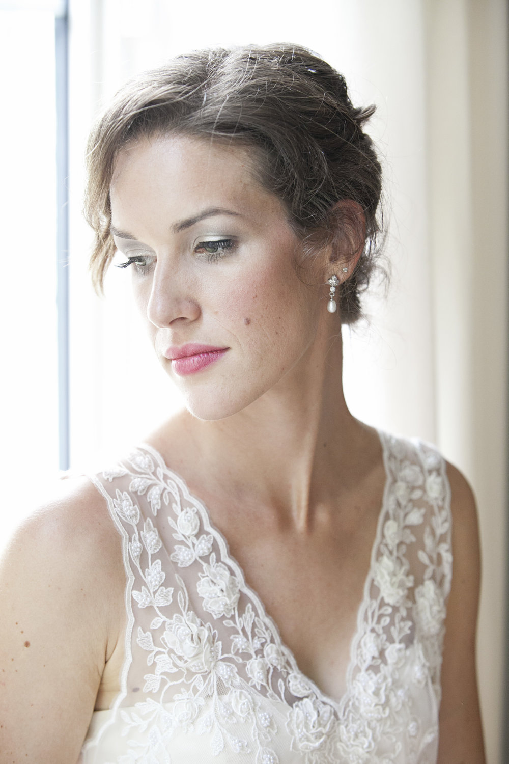 Indoor portrait of bride in lace dress