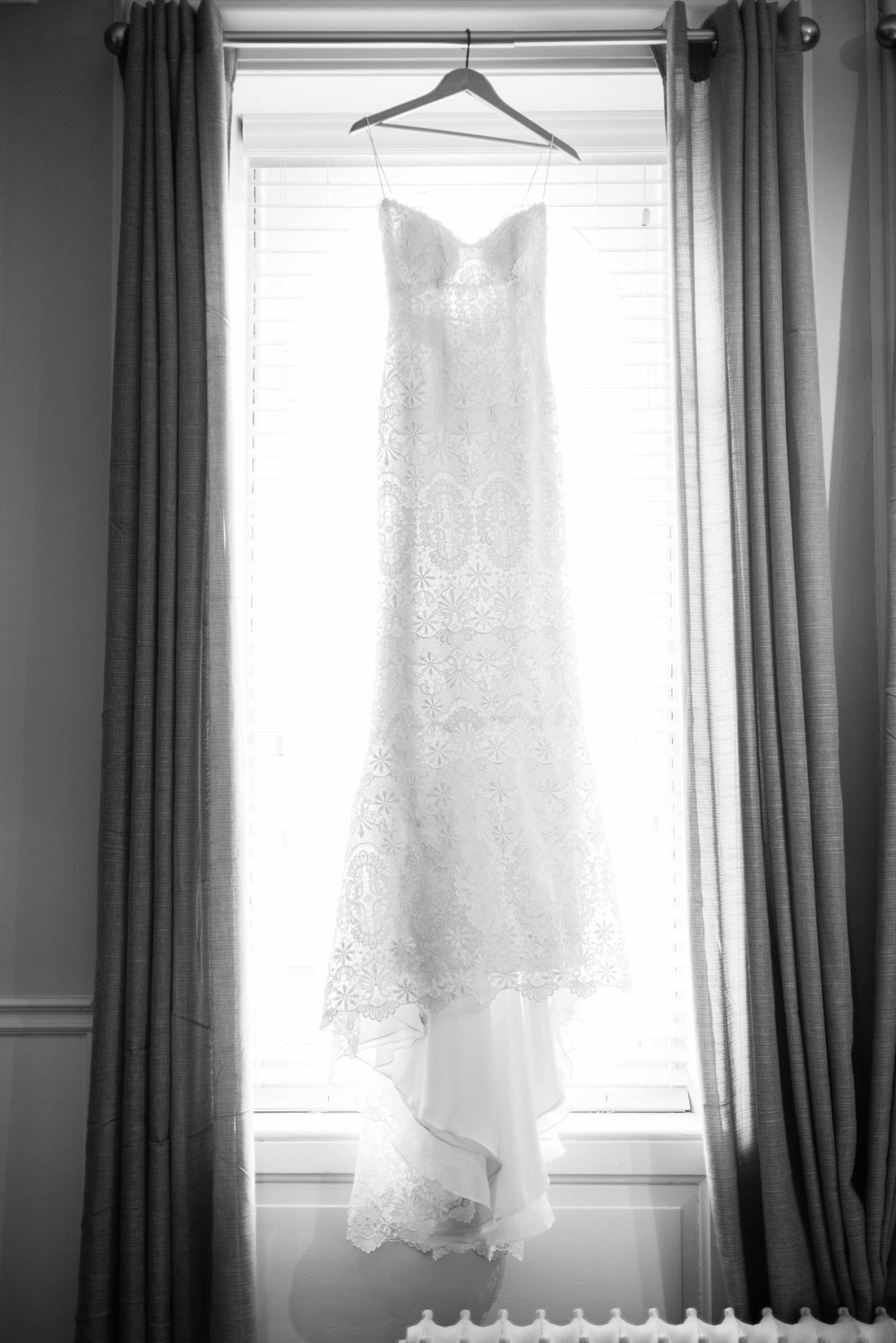 French lace wedding dress in window.