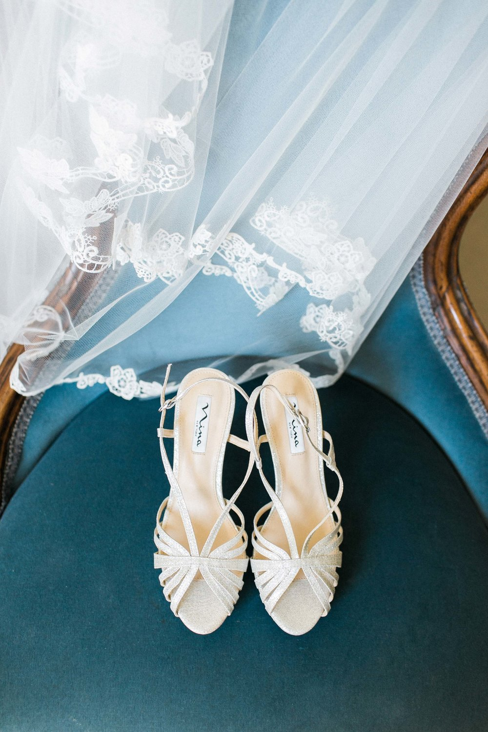 Bride's white wedding shoes and veil