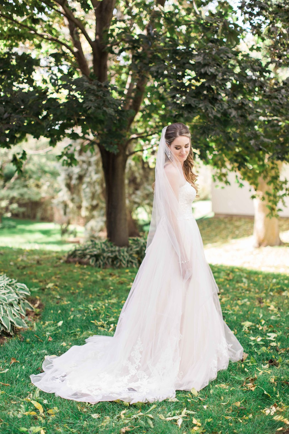 Bride wearing pink tulle wedding dress.