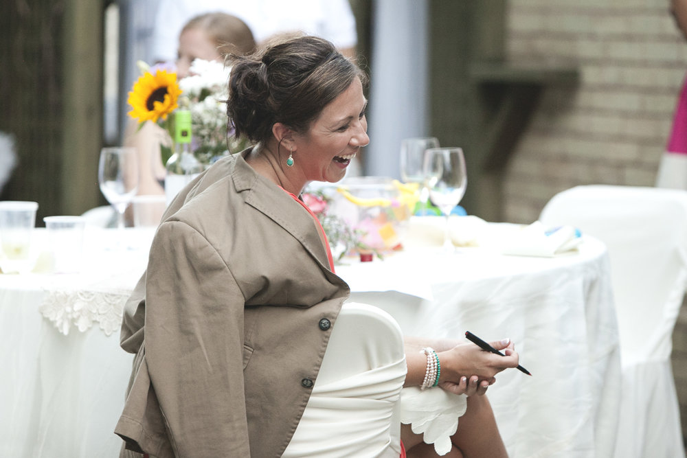 Bridesmaid laughing during kissing game