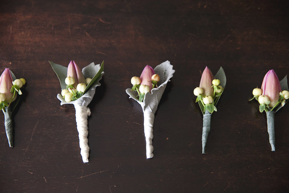 Pink and yellow berry boutonnieres for spring wedding