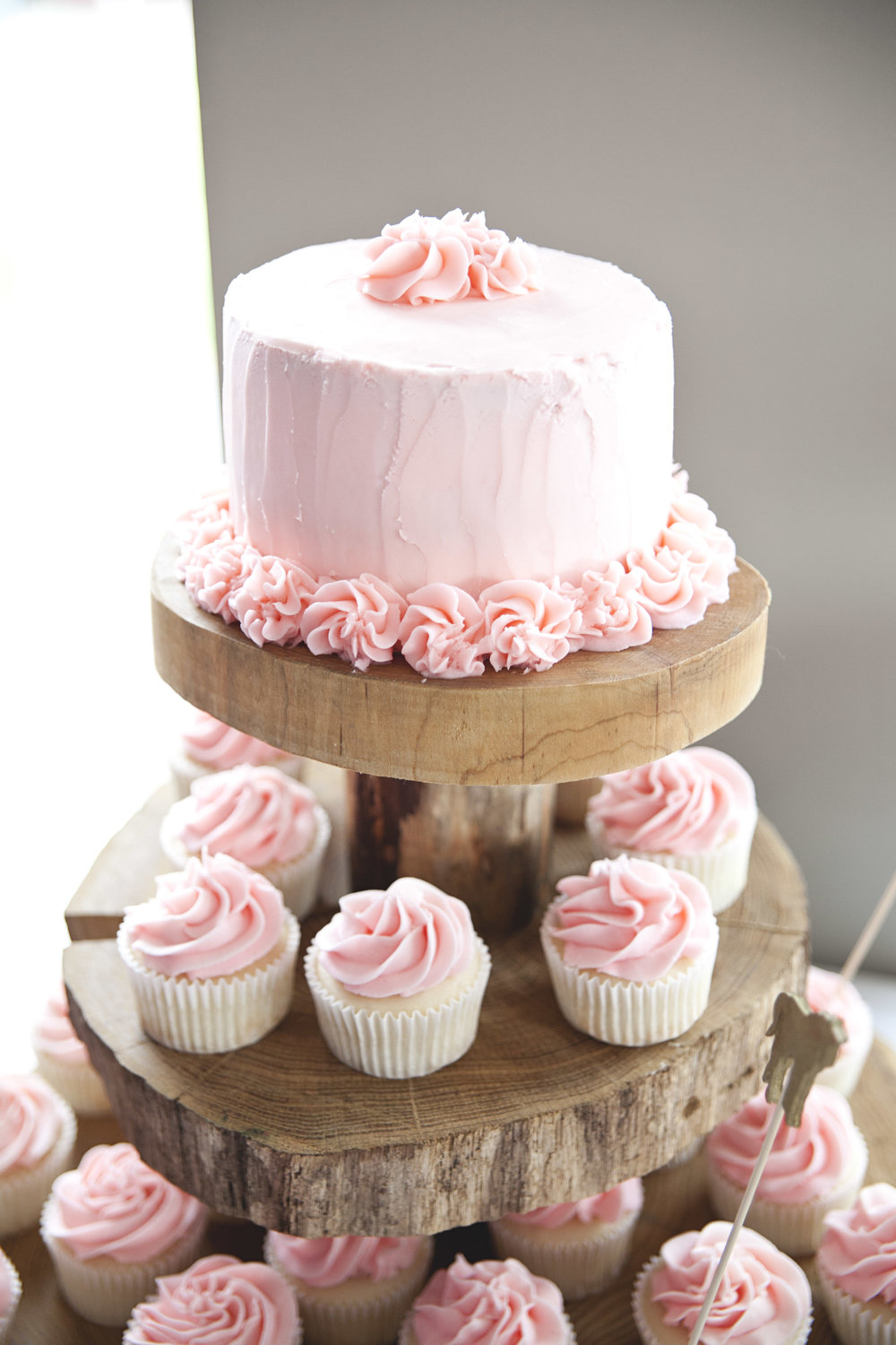 Pink buttercream cupcakes and pink wedding cake