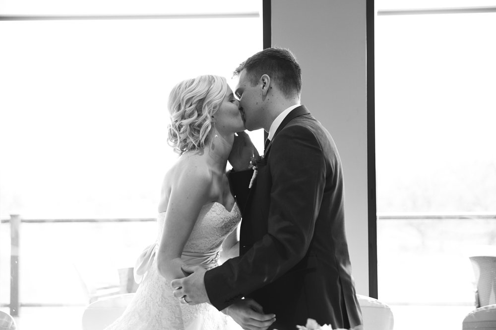 First kiss as husband and wife at golf course wedding