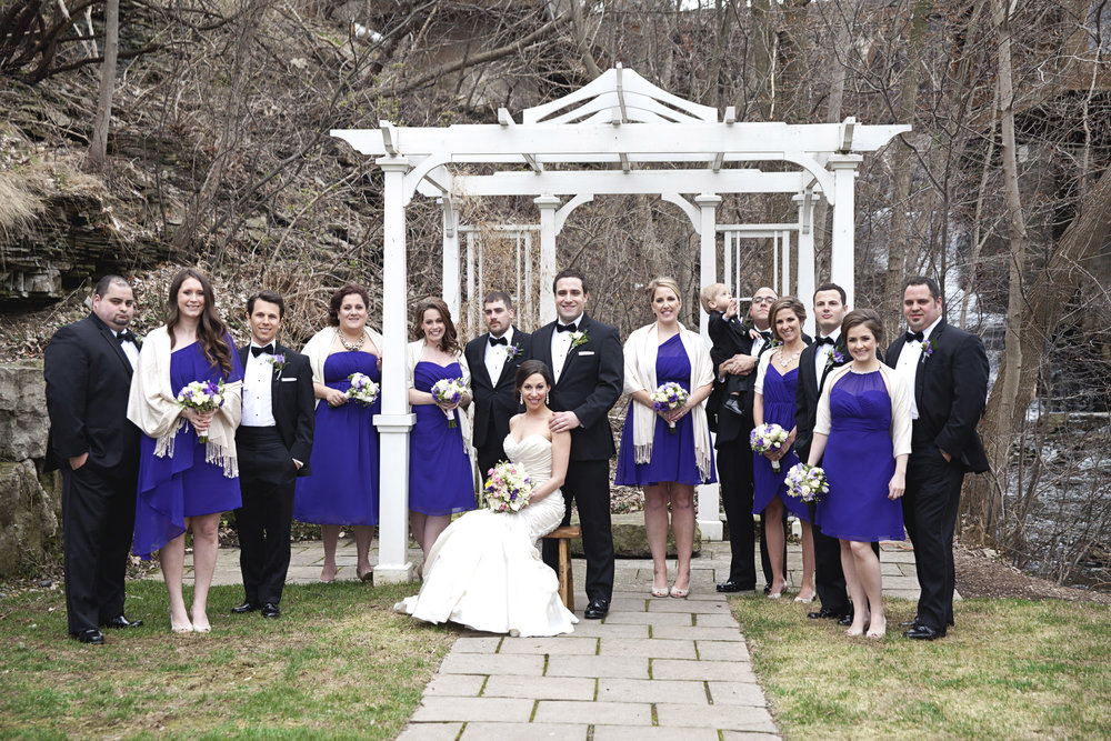 Bridal party in black and purple at the Ancaster Mill