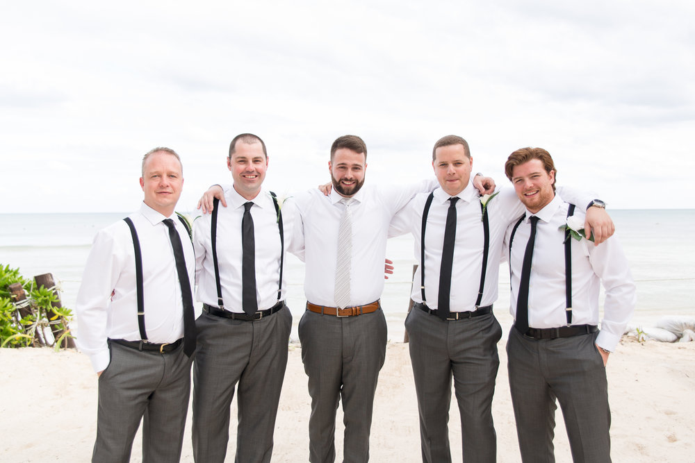 groomsmen at beach ceremony in playa del carmen