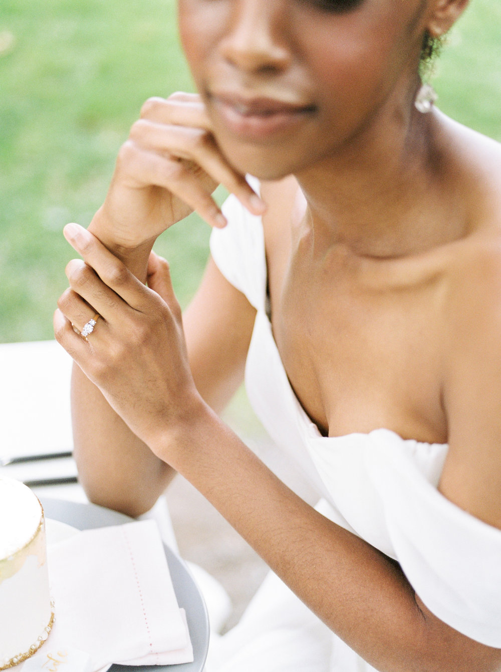 bride wearing gold wedding ring