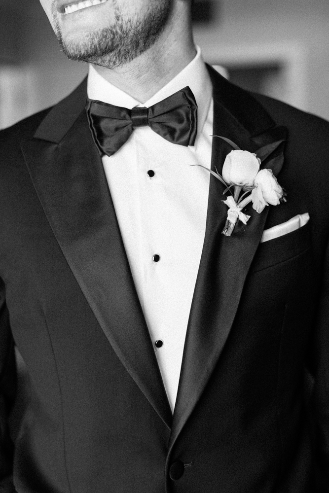 groom wearing black tux and bowtie