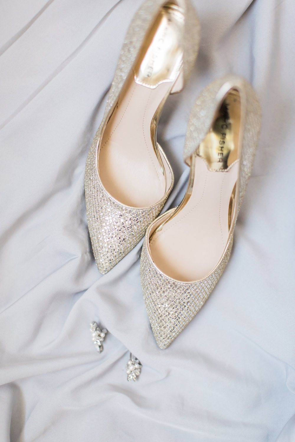 bride's wedding shoes and jewlery