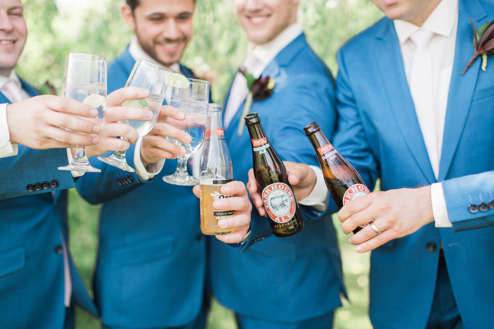 groomsmen wearing blue suits at a summer wedding