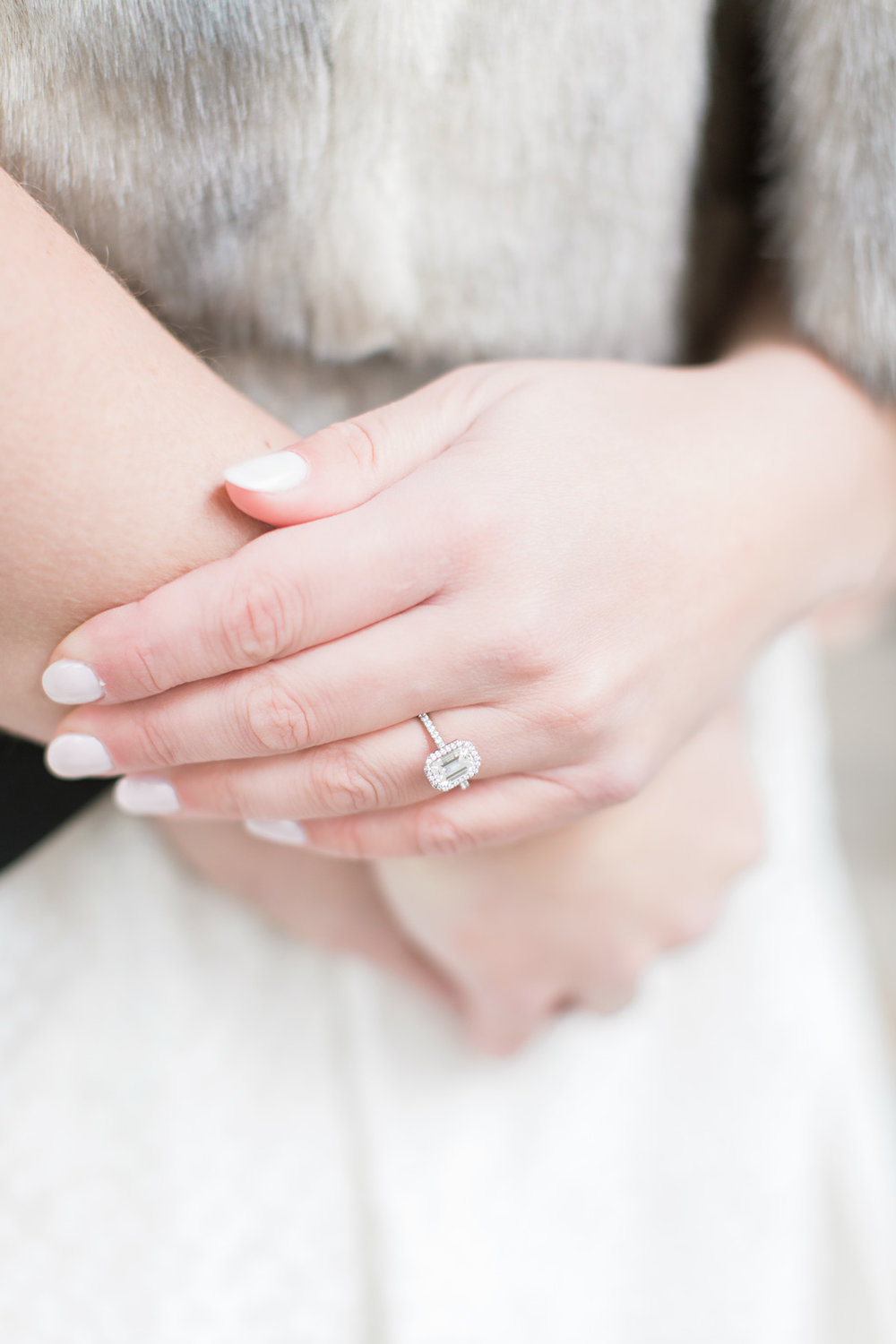 white hold engagement ring