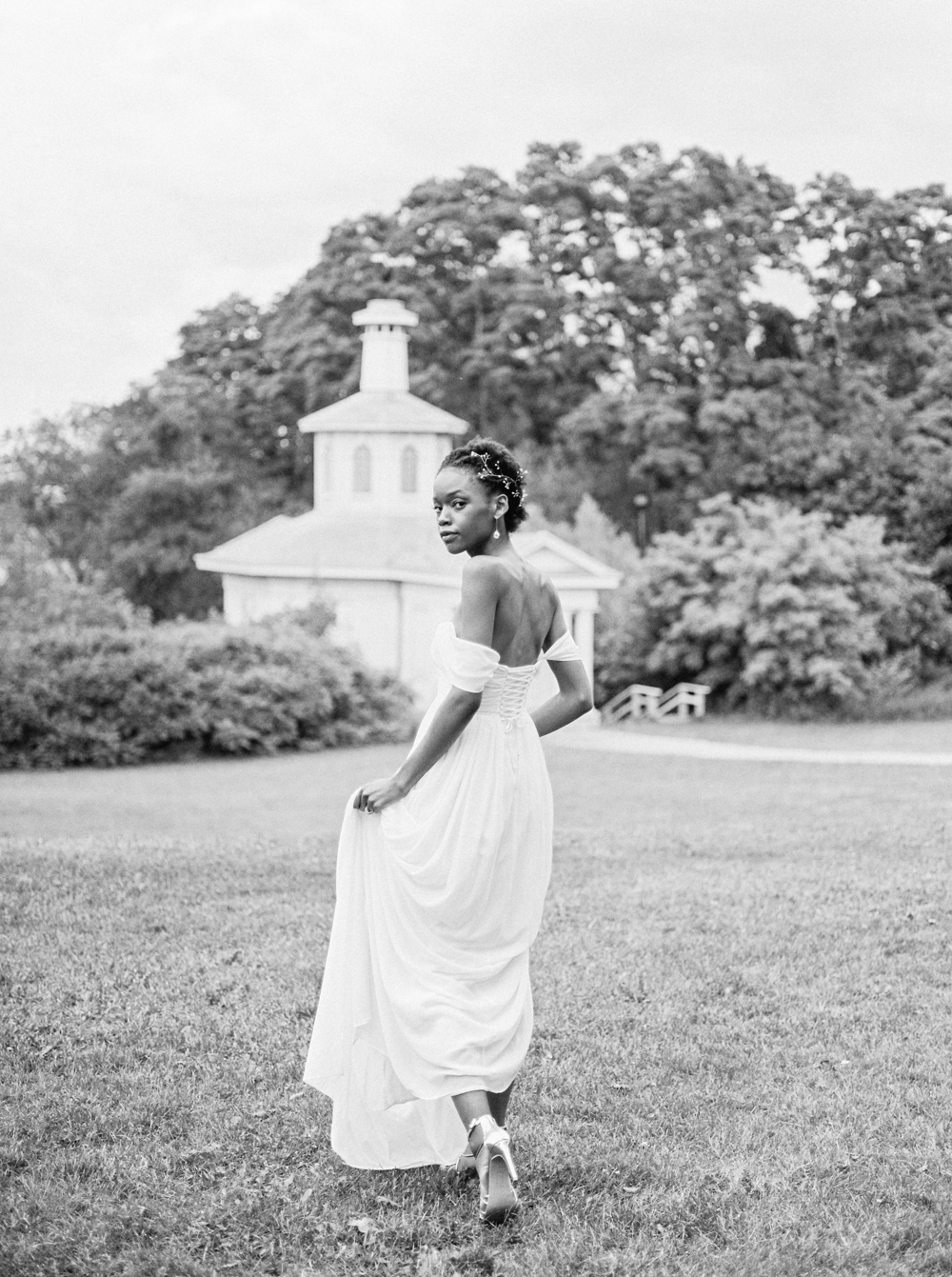 bride wearing off the shoulder wedding dress
