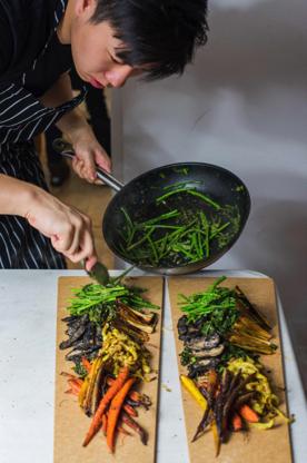 Lucas Sin cooking at Junzi Kitchen, photograph provided by Junzi Kitchen