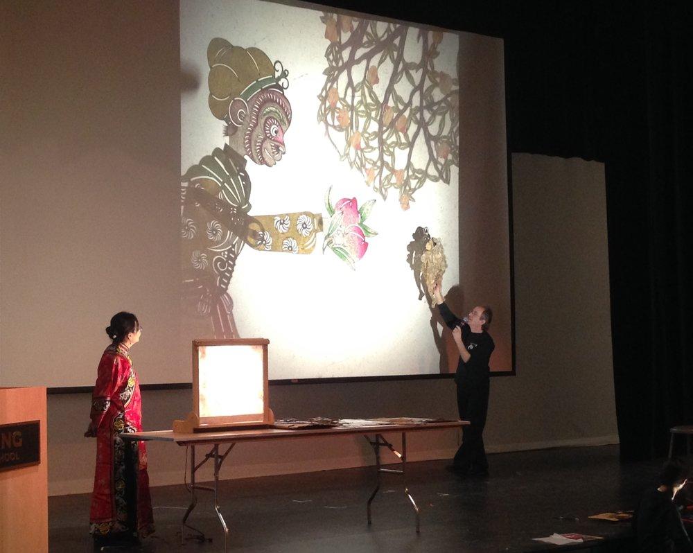 CTW's co-Artistic directors Kuang-Yu Fong and Stephen Kaplin at shadow play demonstration at Kings School, Stamford, Connecticut 中国戏剧工作坊的艺术总监 冯光宇和史蒂芬.凯派林在康州斯坦福的Kings School为观众演示讲解皮影戏