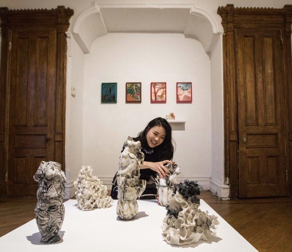 Renqian Yang with her works. Photograph by Nadia Peichao Lin. ©Renqian Yang and Lan Zhaoxing, courtesy Fou Gallery.