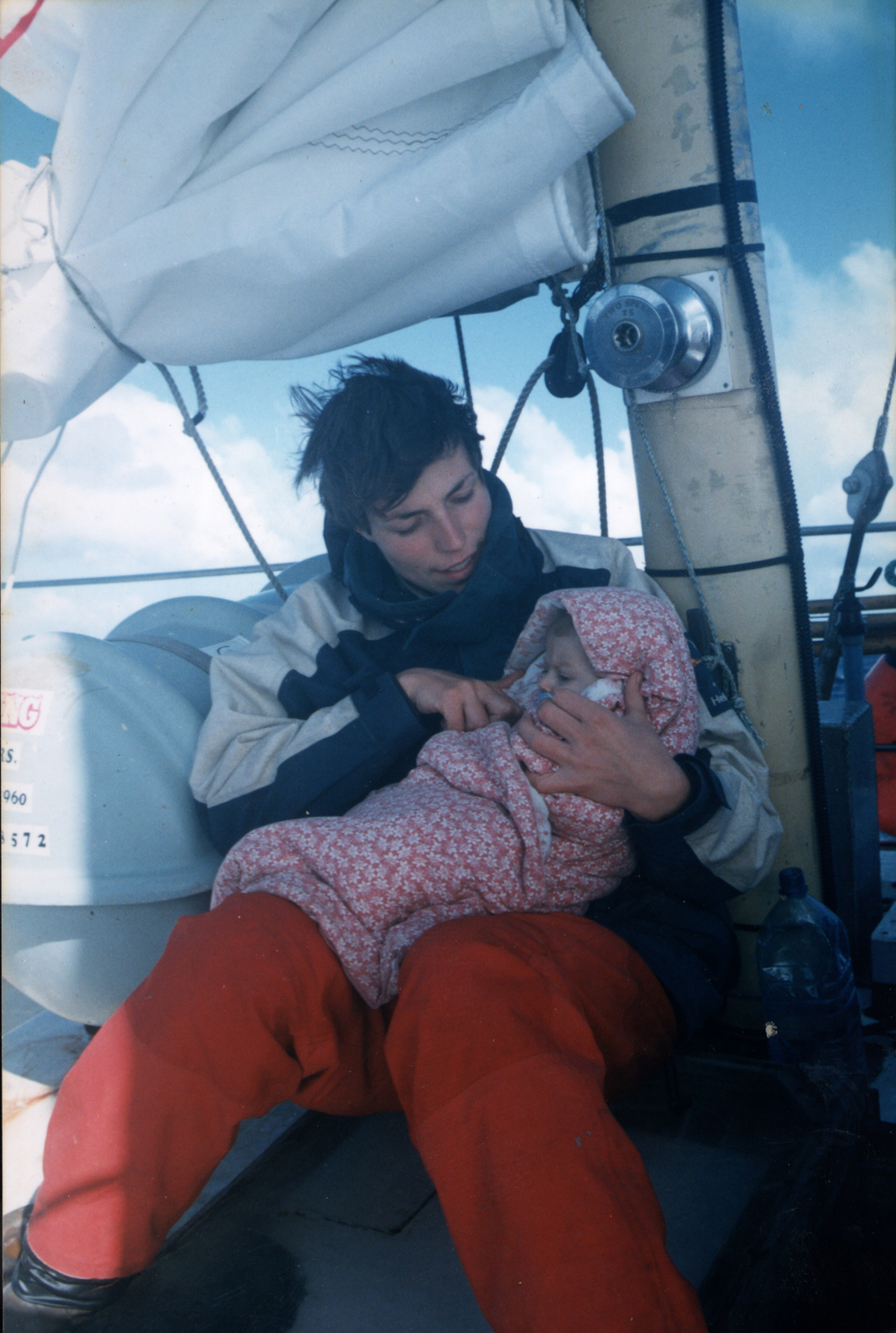 Cradling my four-month-old daughter Freyja, on the deck of my boat, crossing from New Zealand to Australia