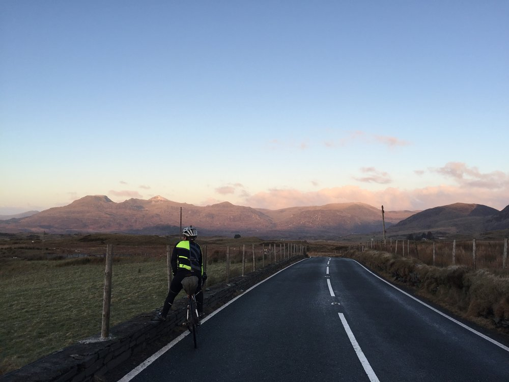 Syndicate athlete Rickie Cotter contemplates sunrise over Snowdonia. (Photo: E. Chappell)
