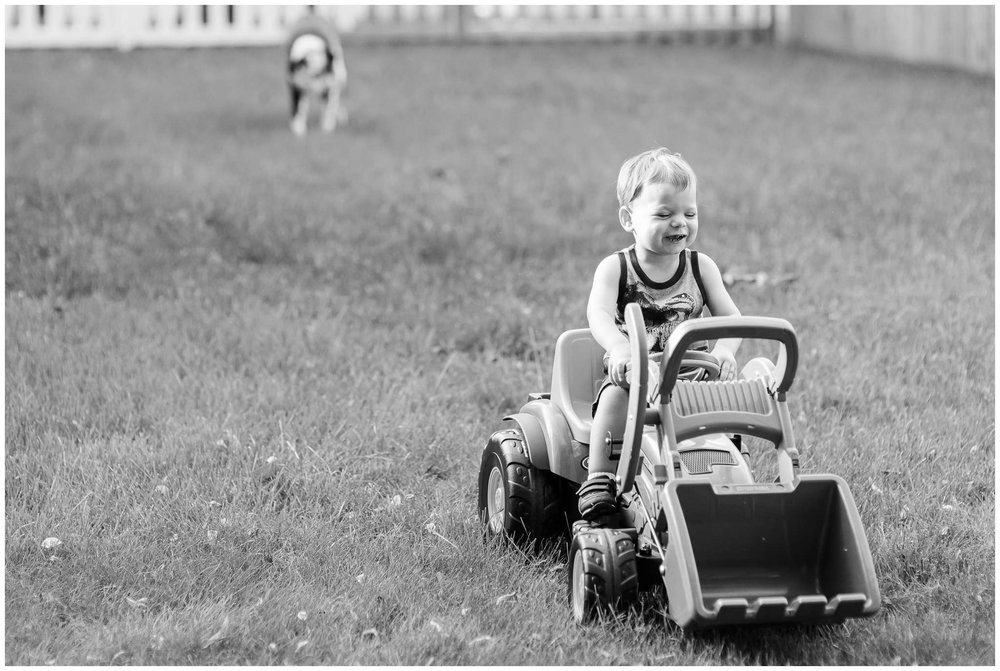 Liam adores his daddy! Any chance he can to do what da da is doing he does it! He went and got his little lawnmower in these photos and started following Hunter. It was so cute!