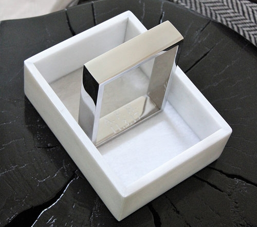 Small white marble tray with polished nickel handles.