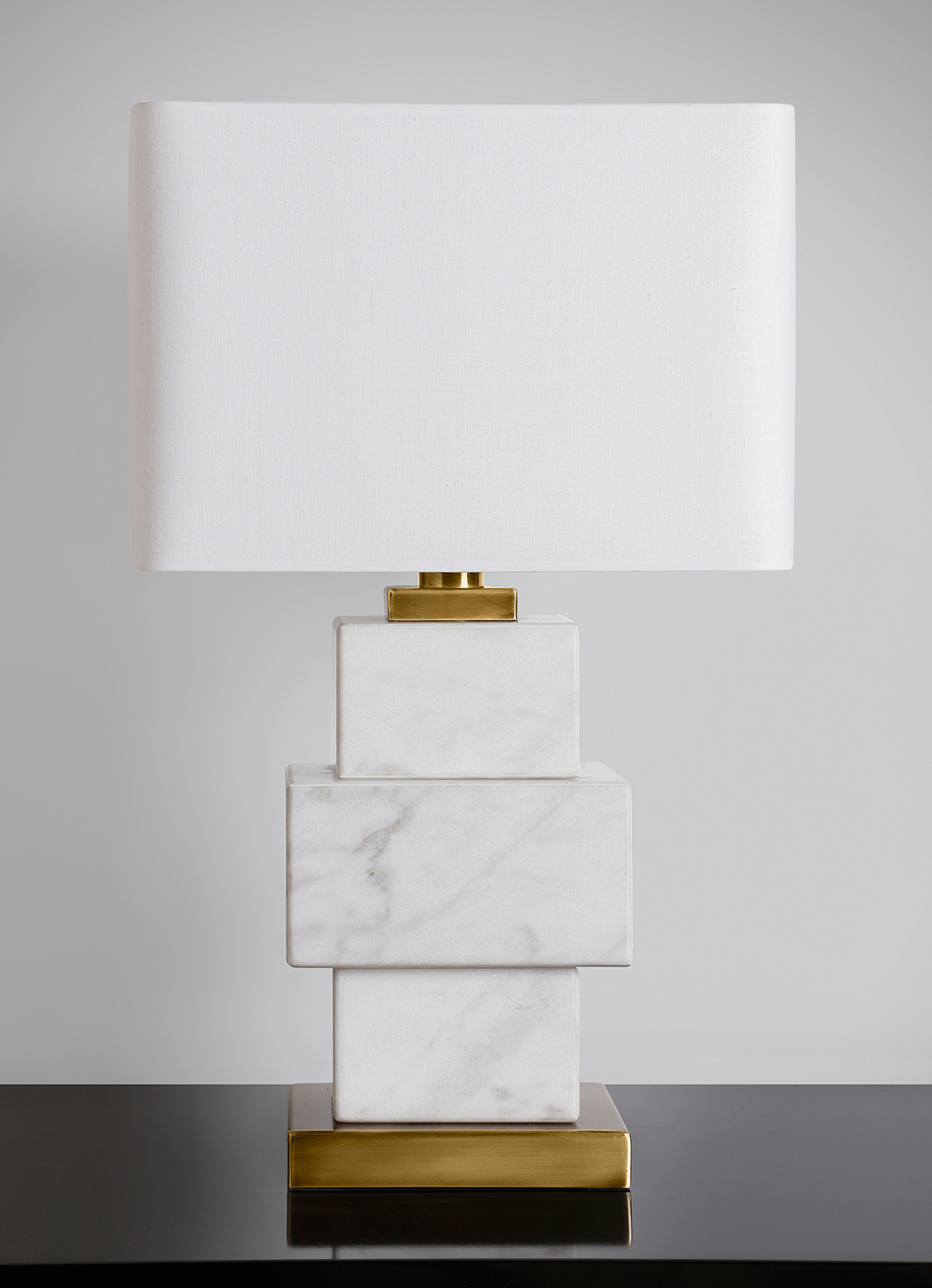 Luxury handmade white triple block marble lamp with bronze details.