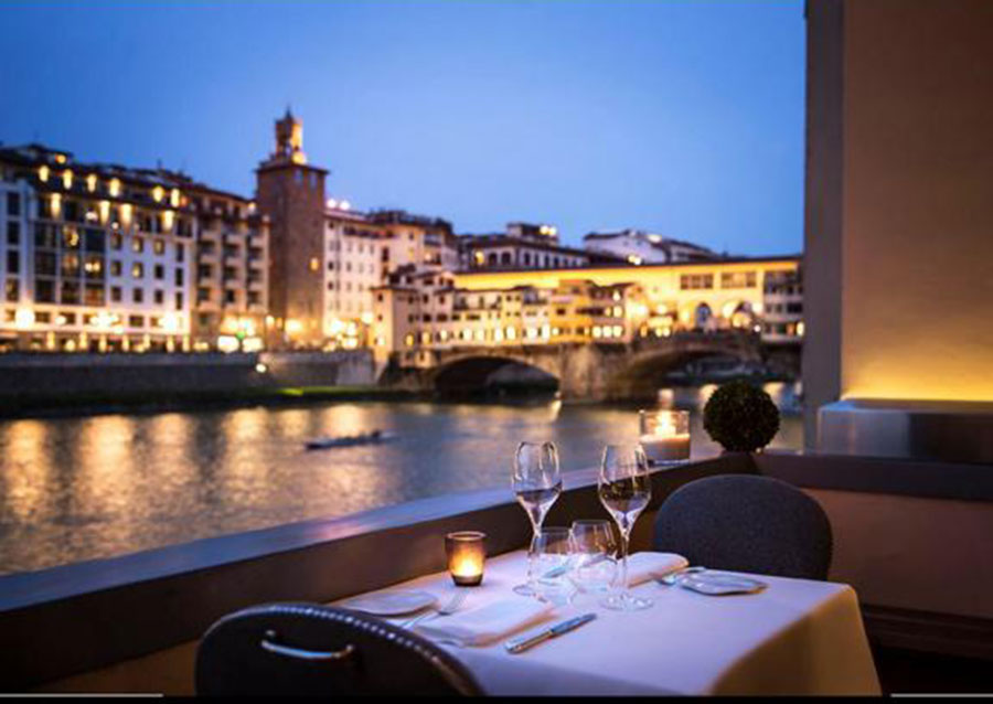 Top Restaurant Dining at Borgo San Jacopo at the terrace over the river.
