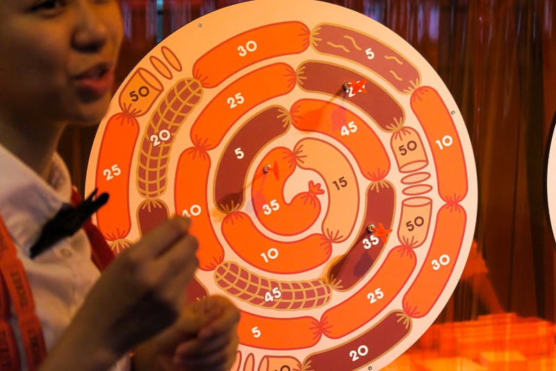 Holographic Sausage, a magnetic darts game where the player tries to hit the bullseye of a spinning sausage wheel.