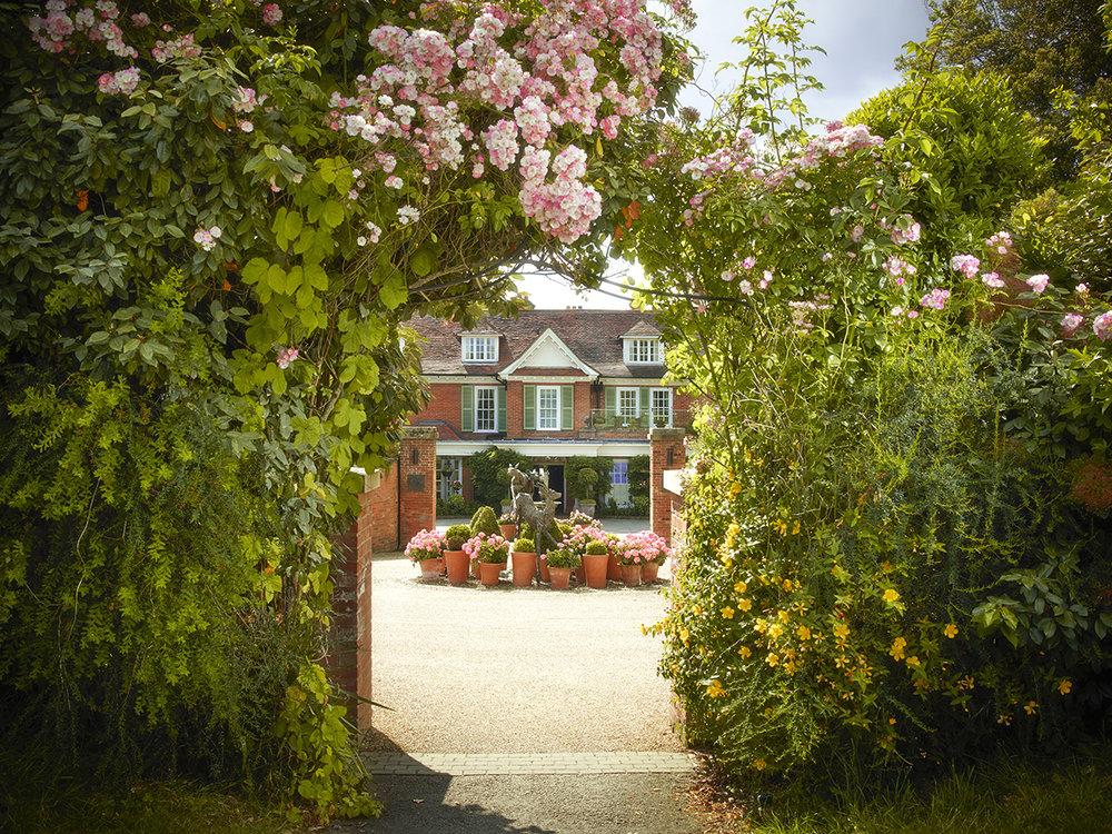 Chewton Glen - Exterior Shot - Entrance with Roses.jpg