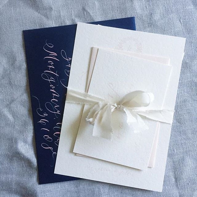 Light blush with a pop of navy. We also used a fancier script than usual, and we like it!