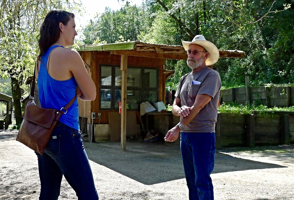 Hannah interviewing Mark, the owner of Devil's Gulch Ranch