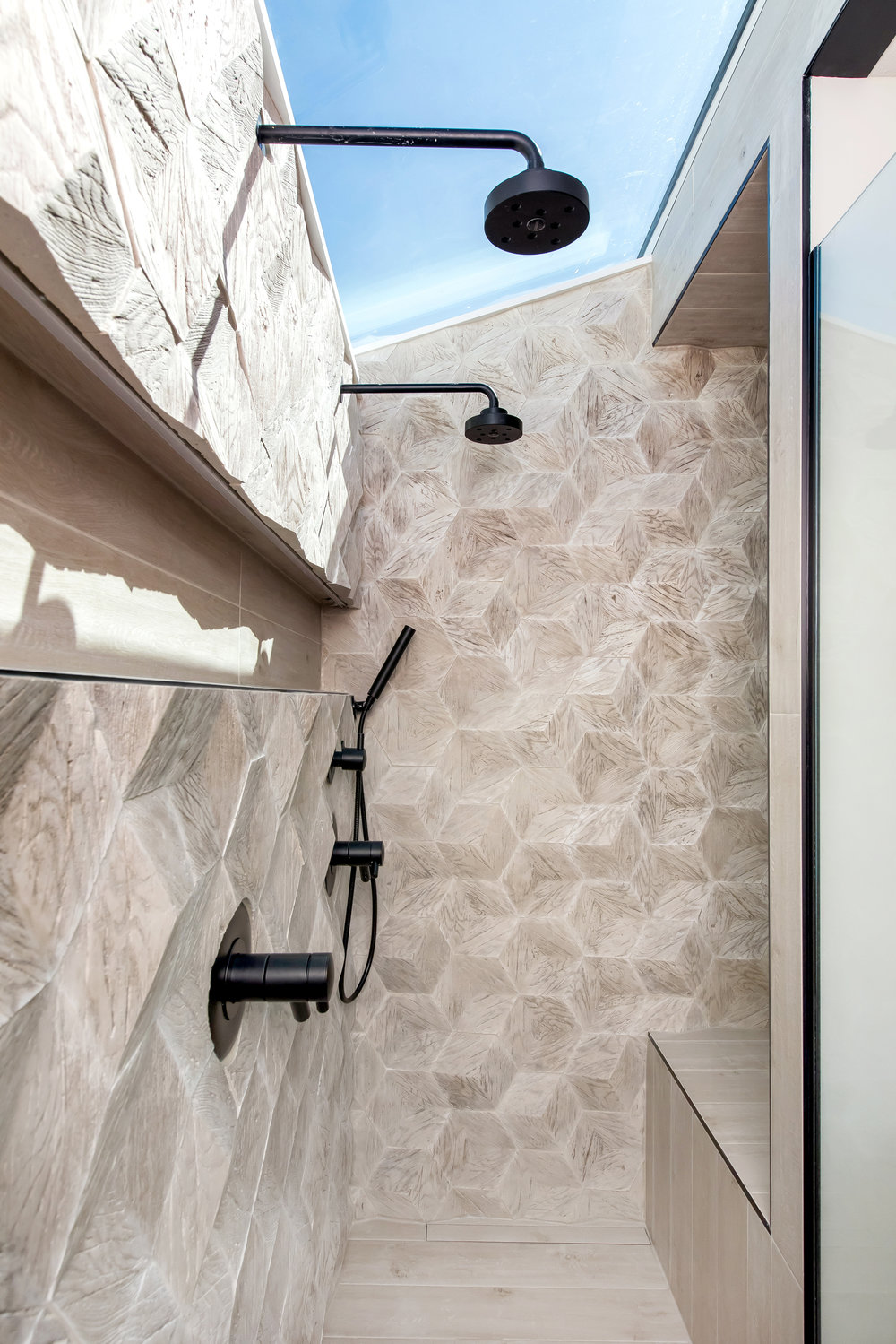 3D Hexagon Tile - This en-suite shower really deserves it's own post so we'll keep this brief and just point out another fantastic integration of hexagons….they're 3D people!!!  And yes, that is a skylight in the shower…like I said – separate post is coming.