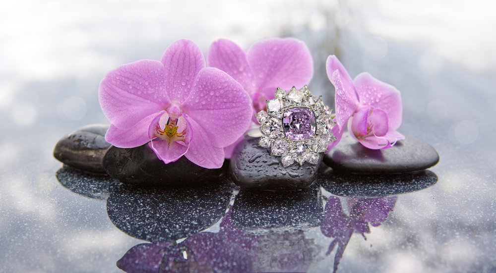 The Victorian Orchid, a rare natural vivid purple diamond stuns in this one of a kind designer flower ring by Scott West. One of the rarest colors ever found in the natural color spectrum, this remarkable stone was on display at the  Natural History Museum of Los Angeles County  this past December 2016.