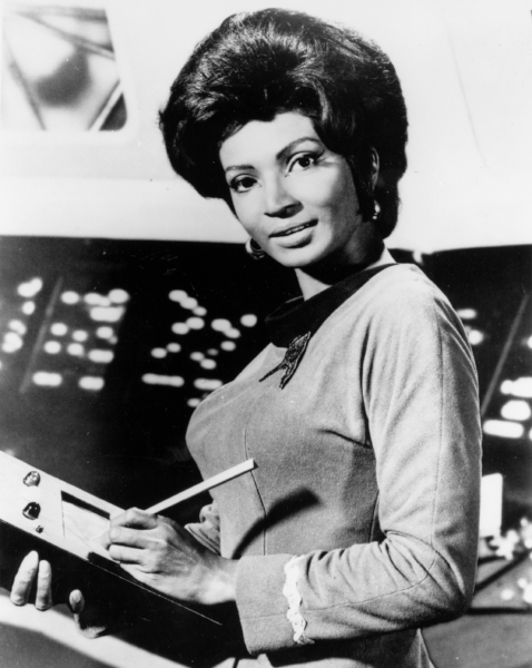 The secret to having a screen in front of you is to continue to engage the people who are with you, as Uhura illustrates with the first iPad-type device.