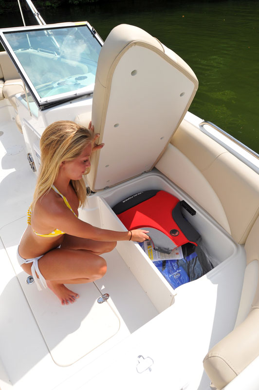 girl getting something out of boat storage