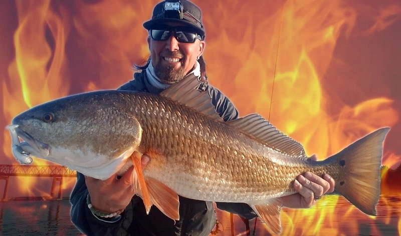 Red drum w/ fire behind fisherman