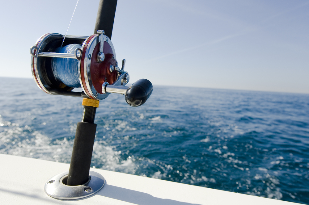 Florida Fishing - Casting rod in rod holder on boat