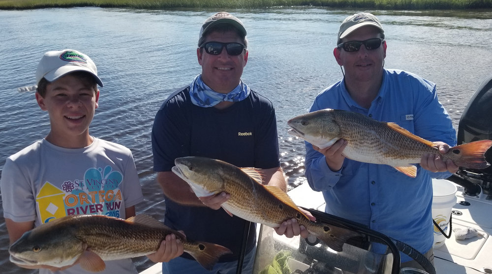 3 nice redfish caught with Captain Don Taylor