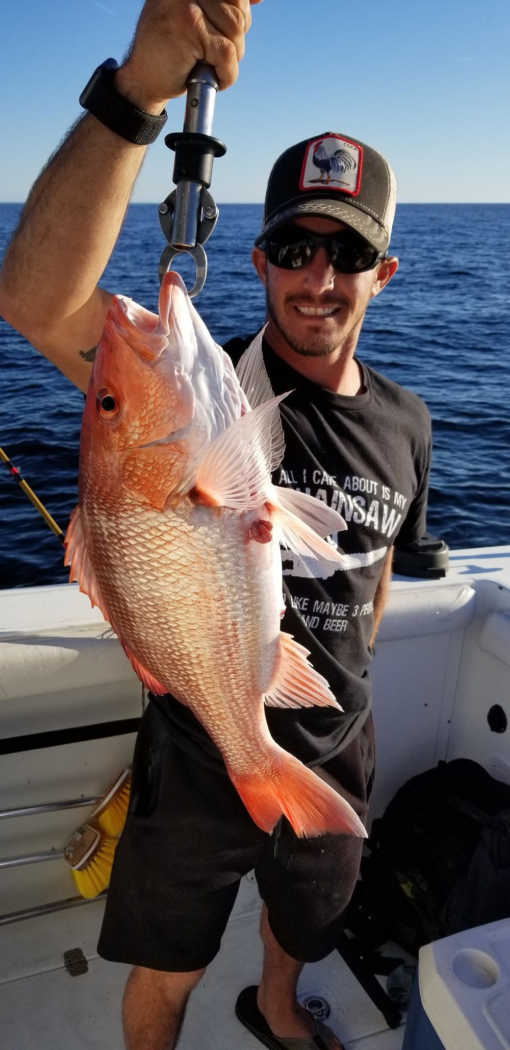 Man holding red snapper catch