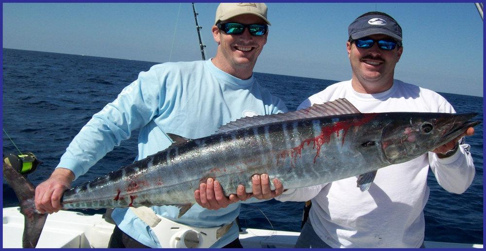 large wahoo held by two fisherman