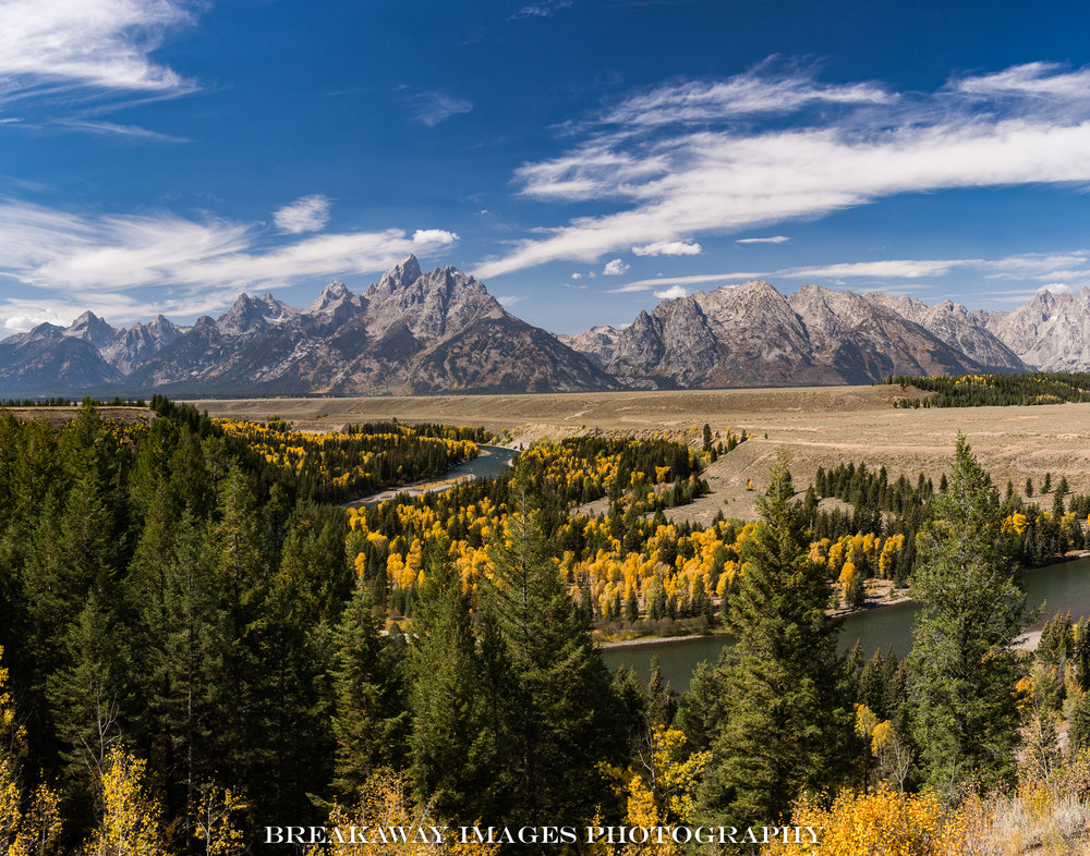 Grand Tetons and the Snake River photographed from where Ansel Adams made his iconic black and while image in 1941.  The trees have grown so much that that image is no longer possible to recreate